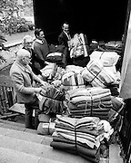 Volunteers from Concern Load blankets and clothing relief for refugees, to be transported via Bombay in India.<br /> 11/11/1971