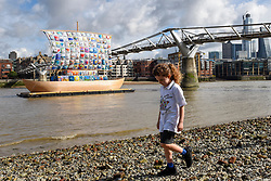 """© Licensed to London News Pictures. 04/09/2019. LONDON, UK. A pupil from Ark Atwood Primary Academy, Westminster takes part in the photocall for the  launch of """"The Ship of Tolerance"""" at Tate Modern, Bankside.  The floating installation by Emilia Kabakov (of Russian conceptual artist duo Ilya and Emilia Kabakov) forms part of Totally Thames Festival and will be moored 4 September to 31 October.  The goal of the artwork is to educate and connect the youth of the world through the language of art. (Permission to photograph obtained)   Photo credit: Stephen Chung/LNP"""