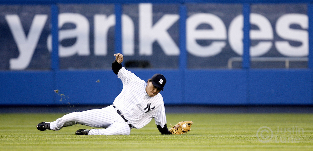 New York Yankees outfield Hideki Matsui breaks his arm while diving for the ball on Thursday 11 May 2006.