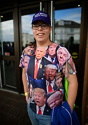 ©  London News Pictures. 17/09/2016. Bournemouth, UK. A party supporter wearing a Donald Trump t-shirt arrives at Day 2 of the 2016 UKIP Autumn Conference, held at the Bournemouth International Centre in Bournemouth, Dorset. On Friday, the party elected Diane James as their new leader, following Nigel Farage resignation after the UK voted to leave the EU in a referendum..  Photo credit: Ben Cawthra/LNP