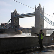 Ativists from the air pollution campaign group Stop Killing Londoners spray paint their message on City Hall and the walls by the Thames Wednesday 21st of March 2018 in Central London, UK. Many thousands of Londoners and people in major UK cities die every year from air pollution mainly from diesel emmissions. The activists want the Mayor of London, Sadiq Khan to do much more to curb the air pollution in London. The spray paint is chalk based and easily removed. In spite of this the activists were arrested for criminal damage. The action is part of a long running campaign and all 4 activists broke their bail conditions imposed the day before from a previous similar action.