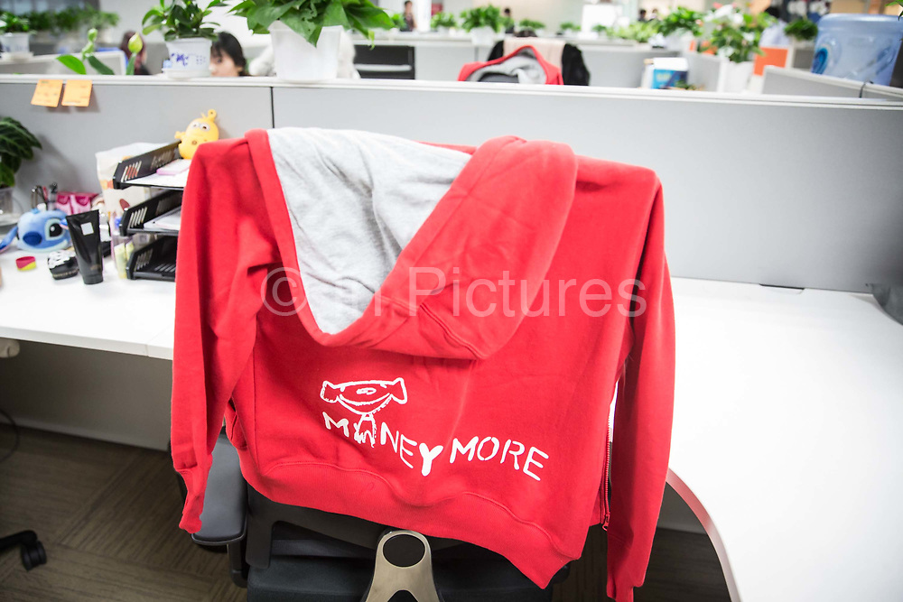 A sweater left on the back of an office chair seen at JD.coms headquarters in Beijing, China, on Monday, Nov. 30, 2015.  JD.com is Chinas second largest online retailer and is locked in a fierce battle with rival Alibaba.