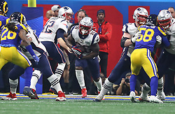 New England Patriots quarterback Tom Brady (12) hands off to running back Sony Michel (26) in the fourth quarter against the Los Angeles Rams during Super Bowl LIII at Mercedes-Benz Stadium in Atlanta on Sunday, February 3, 2019. The Patriots won, 13-3. Photo by Curtis Compton/Atlanta Journal-Constitution/TNS/ABACAPRESS.COM