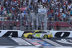 September 30, 2018 - Charlotte, NC, U.S. - CHARLOTTE, NC - SEPTEMBER 30:  #12: Ryan Blaney, Team Penske, Ford Fusion Menards/Pennzoil crosses the finish line to win the Monster Energy NASCAR Cup Series Playoff Race Bank of America ROVAL 400 on September 30, 2018, at Charlotte Motor Speedway in Concord, NC. (Photo by Jaylynn Nash/Icon Sportswire) (Credit Image: © Jaylynn Nash/Icon SMI via ZUMA Press)