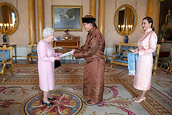 Narkhuu Tulga (centre), Ambassador of Mongolia, accompanied by Burmaa Batbold, presents his credentials to Queen Elizabeth II during a private audience at Buckingham Palace, London.