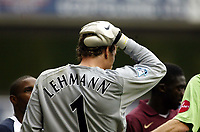 Photo: Chris Ratcliffe.<br />Tottenham Hotspur v Arsenal. The Barclays Premiership.<br />29/10/2005.<br />Jens Lehmann after being hit on the head by a conker