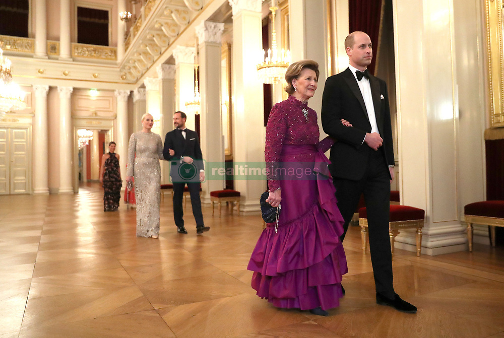 The Duke of Cambridge is escorted into dinner by Queen Sonja of Norway followed by Crown Princess Mette Marit of Norway and Crown Prince Haakon of Norway at the Royal Palace, Oslo, Norway and the end of the third day of his tour of Scandinavia.