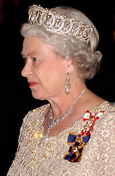 File photo dated 13/10/2002 of Queen Elizabeth II arriving for dinner at the Canadian Museum of Civilization in Gatineau, Canada wearing the Grand Duchess VladimirÕs Tiara. Princess Eugenie may follow in the footsteps of her mother, Sarah Ferguson, Duchess of York, and wear the York diamond tiara on her wedding day.