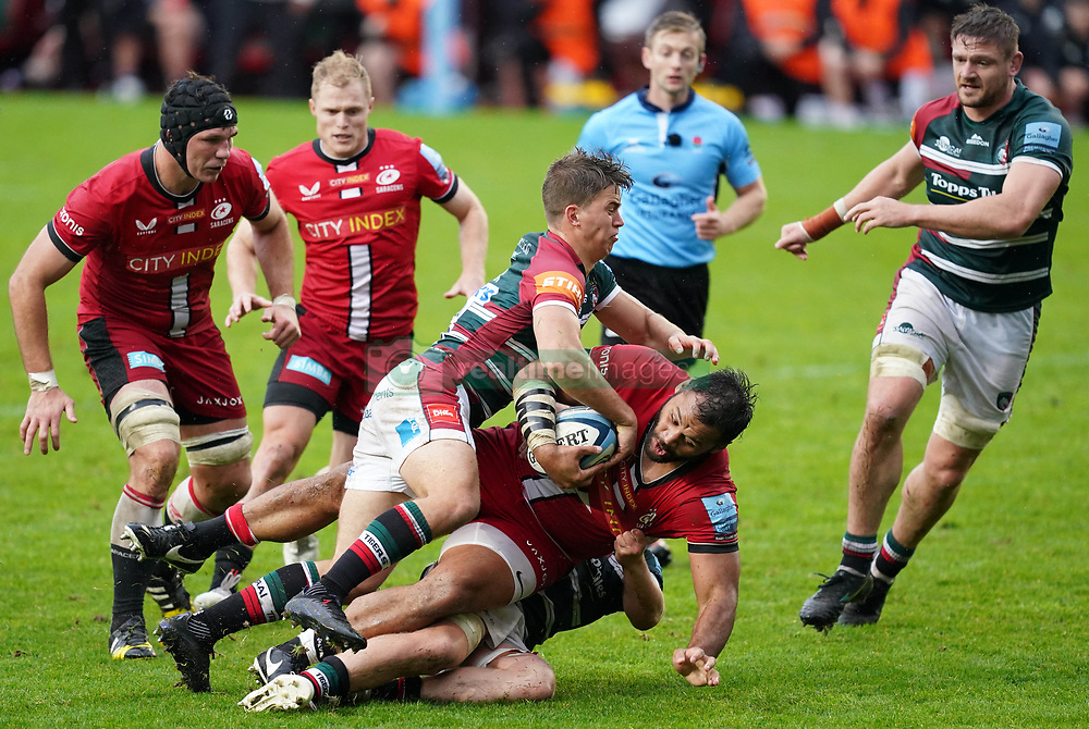 Saracens' Billy Vunipola (centre) is tackled by Leicester Tigers' Harry Potter (top) during the Gallagher Premiership match at Mattioli Woods Welford Road Stadium. Picture date: Saturday October 2, 2021.