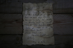 August 21, 2017 - Gaza, Palestine - A message that was written by Bethany Wright and her boyfriend Zac Marriner, and found in a bottle by Palestinian fisherman Jihad al-Soltan off a Gaza beach, is seen in Gaza August 21, 2017.....The Gazan fisherman says he contacted Bethany and Zac in greech who expressed being happy their message reachea Gaza and they pass their regarda to Palestinian people. Bethany and Zac have been contacted by joutnalists to find the origin of this message in a bottle story. They sent him photos of them through email. They said they are happy their message reached Gaza. (Credit Image: © Majdi Fathi/NurPhoto via ZUMA Press)