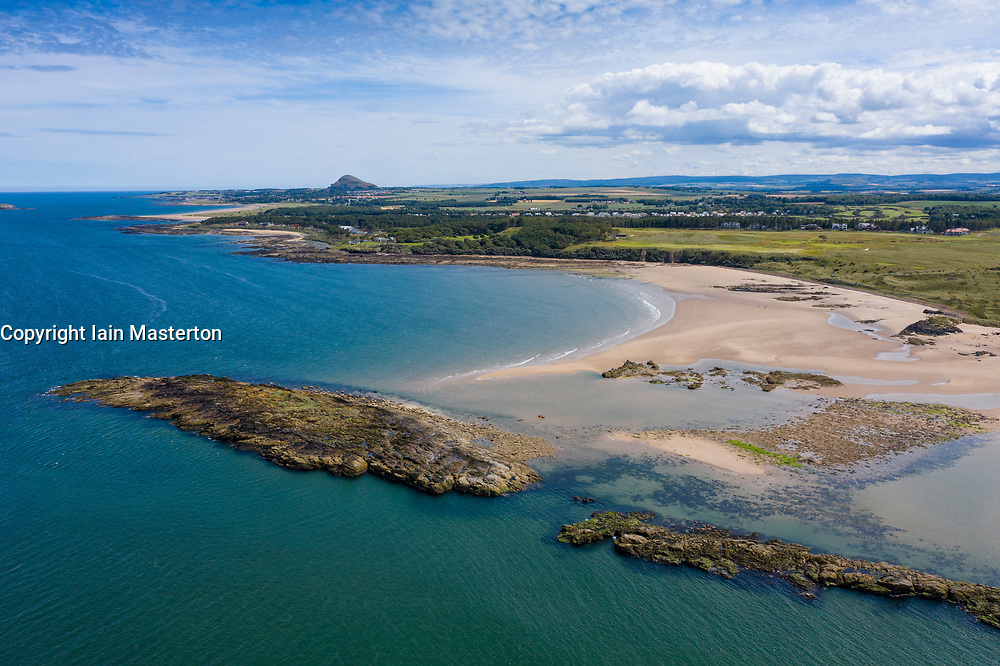 Aerial view of small islet of Eyebroughy on coastline and beaches on coast adjacent to Archerfield near Gullane  in East Lothian, Scotland, UK