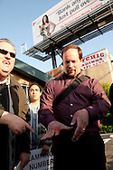 Protesters gather at the Family Radio Rapture Headquarters in Oakland, California on May 21, 2011. Some protesters staged a mock fight with fake blood.