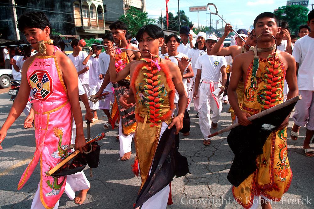 THAILAND, PHUKET ISLAND Chinese Vegetarian Festival,  believer considered spirit mediums in a trance, do body piercing