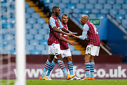 Christian Benteke of Aston Villa celebrates with Fabian Delph after scoring his second goal to make it 2-1 - Photo mandatory by-line: Rogan Thomson/JMP - 07966 386802 - 07/04/2015 - SPORT - FOOTBALL - Birmingham, England - Villa Park - Aston Villa v Queens Park Rangers - Barclays Premier League.