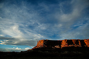 SHOT 10/14/16 6:19:18 PM - Last light on a mesa during the White Rim mountain biking trip in Canyonlands National Park just outside of Moab, Utah. The White Rim Road is a 71.2-mile-long unpaved four-wheel drive road that traverses the top of the White Rim Sandstone formation below the Island in the Sky mesa of Canyonlands National Park in southern Utah in the United States. The road was constructed in the 1950s by the Atomic Energy Commission to provide access for individual prospectors intent on mining uranium deposits for use in nuclear weapons production during the Cold War. Four-wheel drive vehicles and mountain bikes are the most common modes of transport though horseback riding and hiking are also permitted.<br /> (Photo by Marc Piscotty / © 2016)