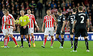 Steve Sidwell of Stoke and Dean Marney of Burnley exchange words amid accusations of time-wasting by Burnley - Football - Barclays Premier League - Stoke City vs Burnley - Britannia Stadium Stoke - Season 2014/2015 - 22nd November 2015 - Photo Malcolm Couzens /Sportimage