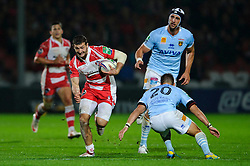 Gloucester Winger (#14) Jonny May is tackled by Perpignan replacement (#20) Dewaldt Duvenage during the second half of the match - Photo mandatory by-line: Rogan Thomson/JMP - Tel: 07966 386802 - 12/10/2013 - SPORT - RUGBY UNION - Kingsholm Stadium, Gloucester - Gloucester Rugby v USA Perpignan - Heineken Cup Round 1.