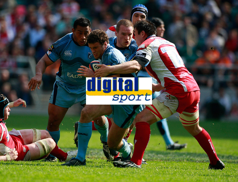 Photo: Richard Lane/Richard Lane Photography. Gloucester Rugby v Cardiff Blues. Anglo Welsh EDF Energy Cup Final. 18/04/2009. Blues' Jamie Robertsis tackled by Gloucester's Gareth Delve.