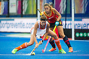 The Netherlands Carlien Dirkse van den Heuvel is watched by Maria Lopez of Spain. Spain v The Netherlands - Unibet EuroHockey Championships, Lee Valley Hockey & Tennis Centre, London, UK on 23 August 2015. Photo: Simon Parker