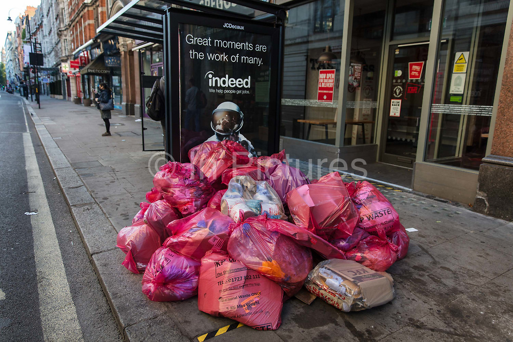 Rubbish left by a bus stop at the end of lockdown on 15th June 2020 in Southampton Row, London, United Kingdom.