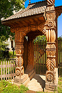 Traditional carved wooden Maramures folk art church gate at Breb, Nr Sighlet, Maramures, Transylvania .<br /> <br /> Visit our ROMANIA HISTORIC PLACXES PHOTO COLLECTIONS for more photos to download or buy as wall art prints https://funkystock.photoshelter.com/gallery-collection/Pictures-Images-of-Romania-Photos-of-Romanian-Historic-Landmark-Sites/C00001TITiQwAdS8