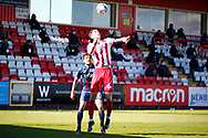 Luke Prosser of Stevenage headers the ball trying to defend the Bradford City goal mouth during the EFL Sky Bet League 2 match between Stevenage and Bradford City at the Lamex Stadium, Stevenage, England on 5 April 2021.