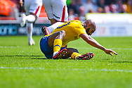 Josh Parker of Charlton Athletic (10) down injured during the EFL Sky Bet League 1 play off first leg match between Doncaster Rovers and Charlton Athletic at the Keepmoat Stadium, Doncaster, England on 12 May 2019.