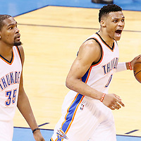 08 May 2016: Oklahoma City Thunder guard Russell Westbrook (0) brings the ball up court next to Oklahoma City Thunder forward Kevin Durant (35) during the Oklahoma City Thunder 111-97 victory over the San Antonio Spurs, during Game Four of the Western Conference Semifinals of the NBA Playoffs at the Chesapeake Energy Arena, Oklahoma City, Oklahoma, USA.