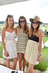 Left to right, the HON.EMILY PEARSON, the HON.CATRINA PEARSON and STEPHANIE CARNEY at the Audi International Polo at Guards Polo Club, Windsor Great Park, Egham, Surrey on 26th July 2014.