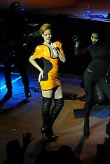 Singer Rihanna wears a tight orange leather dress - 20 NOv 2018