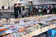 People browsing the books at the South Bank Book Market on 13th April 2021 in London, United Kingdom. The South Bank is a significant arts and entertainment district, and home to an endless list of activities for Londoners, visitors and tourists alike.