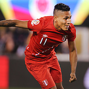 EAST RUTHERFORD, NEW JERSEY - JUNE 17:  Raul Ruidiaz #11 of Peru scores in the penalty shoot out during the Colombia Vs Peru Quarterfinal match of the Copa America Centenario USA 2016 Tournament at MetLife Stadium on June 17, 2016 in East Rutherford, New Jersey. (Photo by Tim Clayton/Corbis via Getty Images)