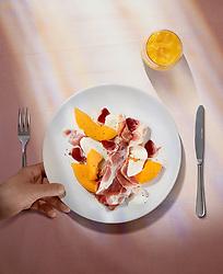 Parma Ham Mango And Mozzarella. Mediterranean summer meal.