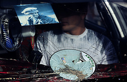 KABUL, 17 JULY 2005...A smashed car window displaying the picture of  Gen Ahmad Shah Massoud , known as the Lion of Panjshir for his success in fighting the Soviet, and the remainings of USA sticker. ..In Afghanistan most of the car window are broken due to bad road conditions.
