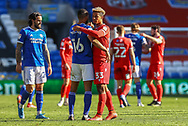 Cardiff City's Curtis Nelson (16) congratulates Nottingham Forest's Lyle Taylor (33) after the final whistle at the EFL Sky Bet Championship match between Cardiff City and Nottingham Forest at the Cardiff City Stadium, Cardiff, Wales on 2 April 2021.