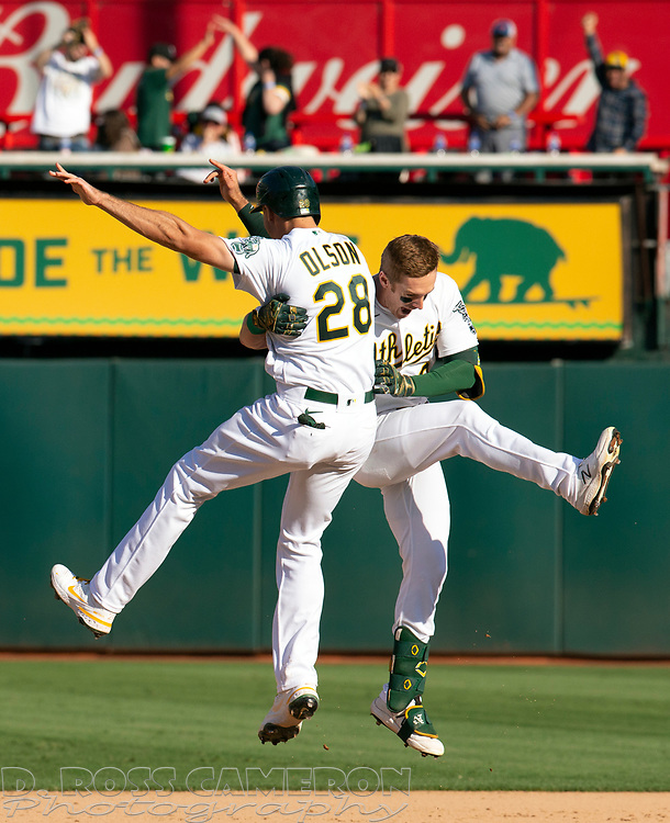 Sep 26, 2021; Oakland, California, USA; Oakland Athletics left fielder Mark Canha (20) celebrates his game-winning hit against the Houston Astros with teammate Matt Olson in the ninth inning at RingCentral Coliseum. Mandatory Credit: D. Ross Cameron-USA TODAY Sports
