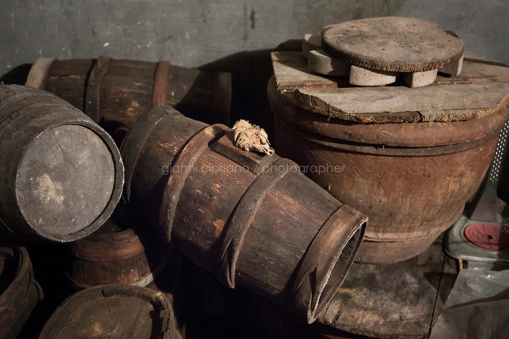 """CALENZANO, ITALY - 24 NOVEMBER 2014: Olive oil earthenware jars (""""orcie"""" in Italian) are stored here in a room of the farm of olive oil producer Federico Dufour in Calenzano, 20 kilometers north of Florence, Italy, on November 24th 2014. These earthenware are no longer used since European regulation imposed the usage of alluminium containers for the storage of olive oil.<br /> <br /> The olive harvest was practically non-existent this fall in Calenzano because of the Bactrocera oleae, an olive fruit fly that this year ravaged entire olive crops. Italy's Institute of Services for Agriculture and Food Market, or ISMEA, calculated that olive oil production fell on average by 35 percent from 302,000 tons from 463,000 the previous year."""