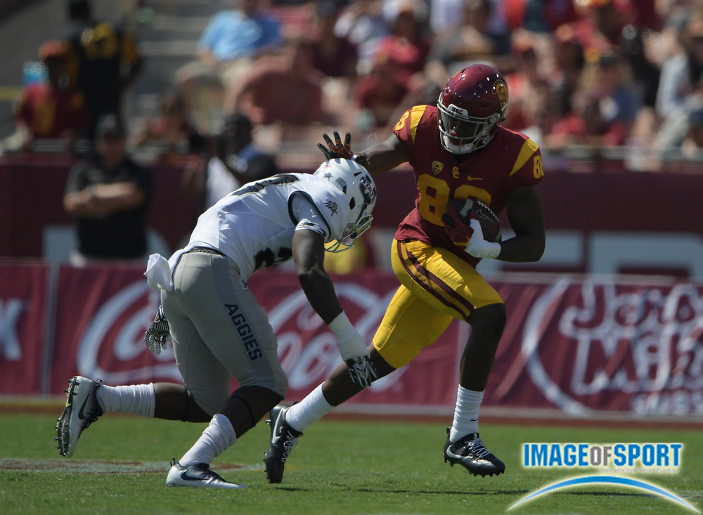 Sep 10, 2016; Los Angeles, CA, USA; USC Trojans tight end Daniel Imatorbhebhe (88) is defended by Utah State Aggies safety Jontrell Rocquemore (27) during a NCAA football game at Los Angeles Memorial Coliseum. USC defeated Utah State 45-7.