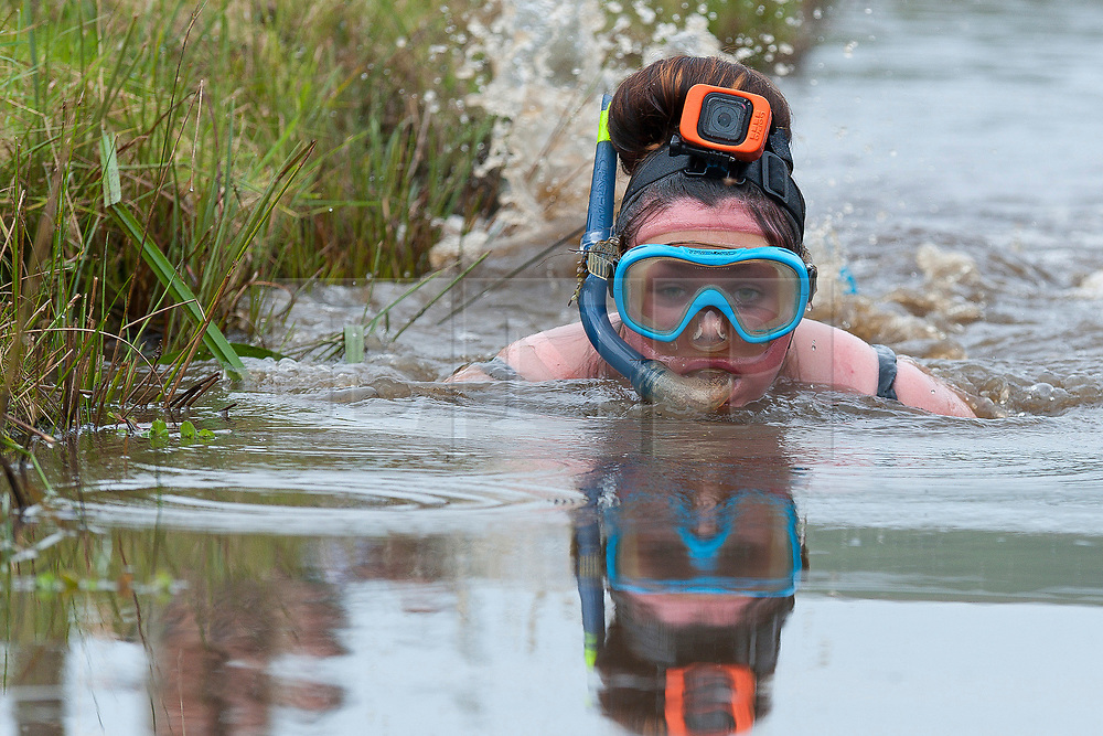 © Licensed to London News Pictures. 27/08/2017. Llanwrtyd Wells, Powys, Wales, UK. The 32nd annual World Bog Snorkelling Championships, conceived over 30 years ago in a Welsh pub by landlord Gordon Green, are held at the Waen Rhydd Bog. Using unconventional swimming strokes, participants swim two lengths of a 55 metre trench cut through a peat bog wearing snorkel mask and flippers. Photo credit: Graham M. Lawrence/LNP