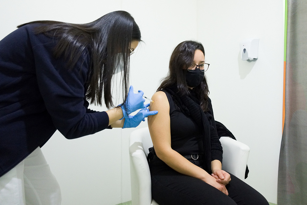 A woman receives a dose of the AstraZeneca COVID-19 vaccine on February 19, 2021 at the Covid Vaccine Center at Mostra d'Oltremare in the Fuorigrotta district in Naples, southern Italy, as part of vaccinations for teachers and school staff.