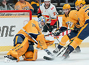 Nashville Predators goaltender Juuse Saros (74) makes a stick save during an NHL game between the Calgary Flames and Nashville Predators at Bridgestone Arena in Nashville, TN