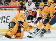 Nashville Predators goaltender Juuse Saros (74) makes a stick save during an NHL game between the Calgary Flames and Nashville Predators at Bridgestone Arena in Nashville, TN