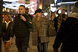 © Licensed to London News Pictures.05/12/2020. London, UK. Londoners are seen making the most of the first Saturday night out in Soho, central London as second national lockdown has ended. Photo credit: Marcin Nowak/LNP