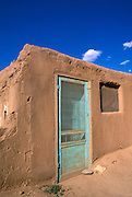 Turquoise door on an adobe house (World Heritage Site), Taos Pueblo , New Mexico