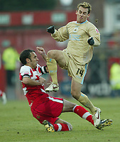 Photo: Aidan Ellis.<br /> Doncaster Rovers v Bristol City. Coca Cola League 1.<br /> 26/11/2005.<br /> Bristol's Luke Wilkshire is tackled by Doncaster's Stephen Foster