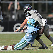 ORLANDO, FL - OCTOBER 24:  Linebacker Kevin Henry #33 of the Tulane Green Wave hits quarterback Dillon Gabriel #11 of the Central Florida Knightsat Bounce House-FBC Mortgage Field on October 24, 2020 in Orlando, Florida. (Photo by Alex Menendez/Getty Images) *** Local Caption *** Kevin Henry; Dillon Gabriel