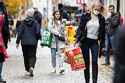 © Licensed to London News Pictures. 31/10/2020. Manchester, UK. The wet weather and tier 3 restrictions don't deter some shoppers in Manchester today. Photo credit: Kerry Elsworth/LNP