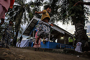 BAYEUN, ACEH, INDONESIA - JULY 11 : <br /> Child of rohingya migrant playing rope jump at temporary shelter camp in Bayeun, East Aceh, Indonesia on July 11. 2015. The boatpeople in Aceh are among thousands of Rohingya and Bangladeshi migrants who arrived in countries across Southeast Asia in May after a Thai crackdown threw the people-smuggling trade into chaos.<br /> ©Nira Cahaya/Exclusivepix Media