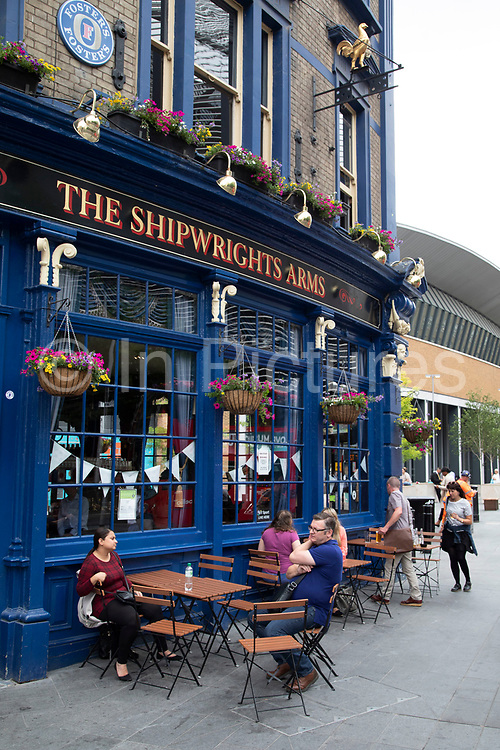 The Shipwrights Arms pub near to the refurbished complete and London Bridge Station is fully open in London, England, United Kingdom. London Bridge Station is a central London railway terminus and connected London Underground station in Southwark, south-east London. It occupies a large area on three levels immediately south-east of London Bridge, from which it takes its name. The main line station is the oldest railway station in London fare zone 1 and one of the oldest in the world having opened in 1836. The station was comprehensively redeveloped between 2009 and 2017 with the rebuilding of all platforms, the addition of two major new street-level entrances, and changes to passenger concourses and retail facilities.
