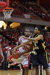 18 February 2009: Brandon Sampay pulls in a rebound keeping it away Reggie Chamberlain.  The Illinois State University Redbirds took the charge out of the Wichita State Shockers 74-59 on Doug Collins Court inside Redbird Arena on the campus of Illinois State University in Normal Illinois